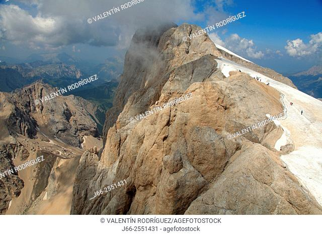 Punta Penia with trippers, seen from viewpoint of the Marmolada. Fassa valley. Dolomites. Italy