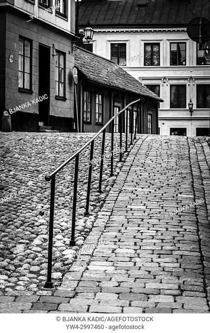 Cobbled hilly street with traditional houses in Sodermalm, Stockholm, Sweden