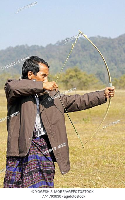 Tribe, man perform Traditional Stone & Bow Competition at Namdapha Eco Cultural Festival, Miao, Arunachal Pradesh, India