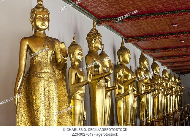 Bangkok, Thailand. Buddhas in the Cloister (Phra Rabiang) Surrounding the Chedis of the first Four Rama Kings, Wat Pho Temple Compound