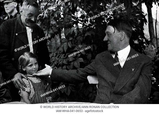 Adolf Hitler 1889-1945. German politician and the leader of the Nazi Party greets a young girl
