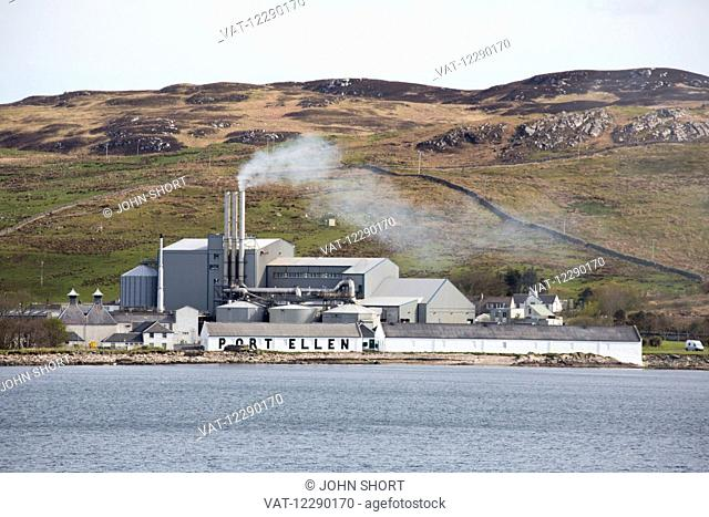 Exhaust coming from stacks on a building on the water's edge at Port Ellen; Isle of Islay, Scotland