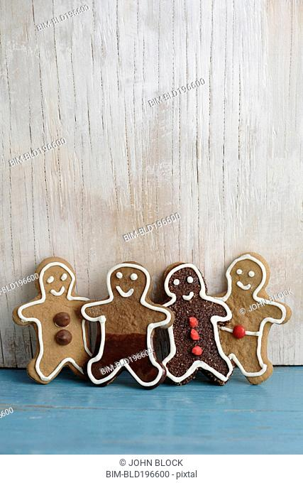 Four gingerbread man cookies in a row