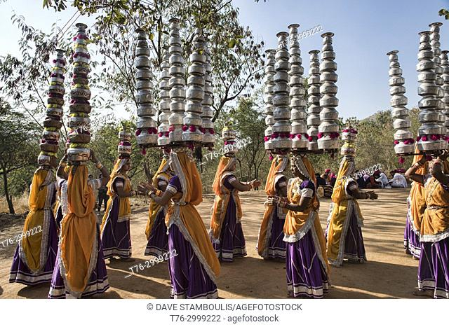 Women performing the Rajasthan and Gujarati Bhavai pot dance, celebrating women's efforts to carry water in the desert, Udaipur, Rajasthan, India