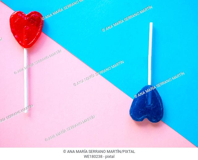 Red and blue lollipops on a pink and blue background
