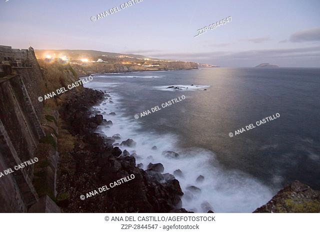 Angra do Heroismo Night seascape from the fortress in Terceira island Azores Portugal