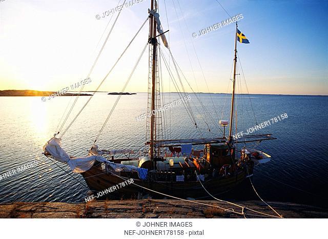 Boat docked by seaside