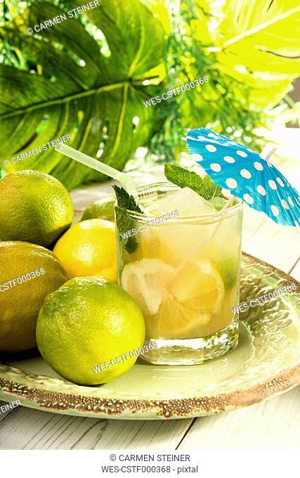Glass of home made lemonade splash with slices of lemon