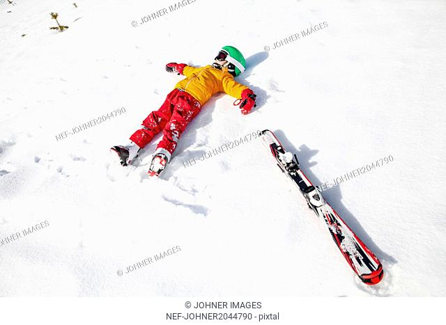 Child on snow with snowboard
