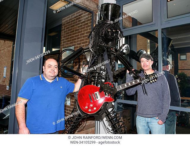 PICTURE SHOWS: Welder/finisher Darren Kenny and artist Simon Weitzman. .....  A unique sculpture of rock musician Slash is going under the hammer