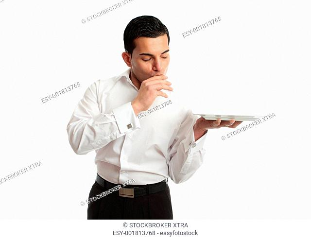 A delighted waiter holding plate and showing love kissing hand in gesture of perfection and love