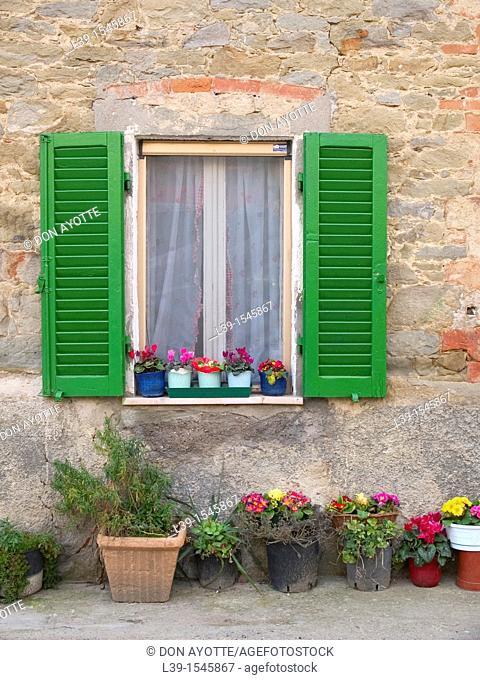 window decorated with flowers in Tuscany, Italy