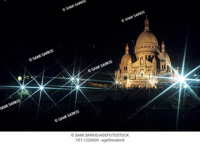 Sacre Coeur lit up at night with flood lights, Paris, France