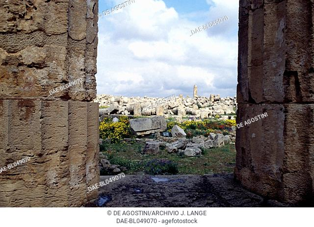 Glimpse of the archaeological area from the columns of the Temple E or Temple of Hera, 460-450 BC, Doric order, ancient city of Selinunte, Sicily, Italy