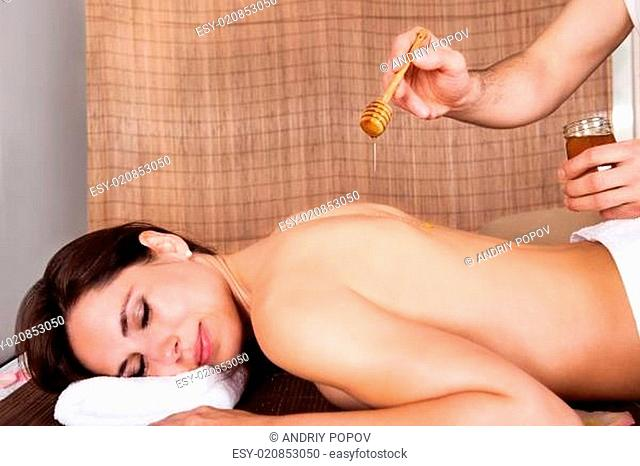 Woman receiving treatment with honey