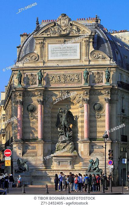 France, Paris, Fontaine Saint-Michel, people