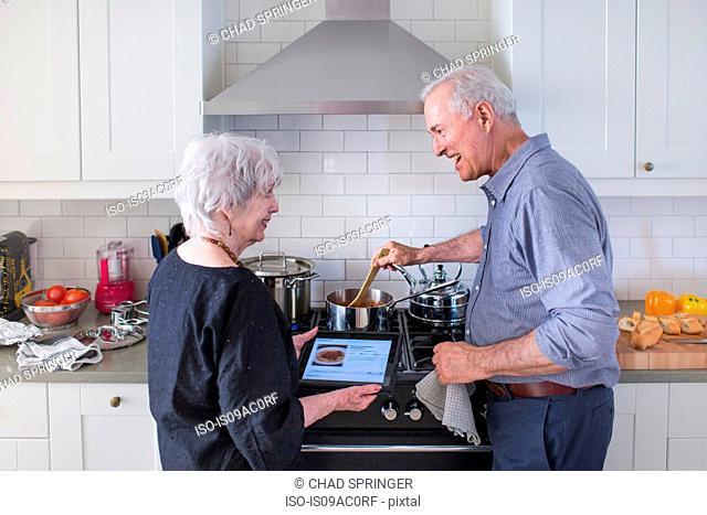Senior couple preparing food at home