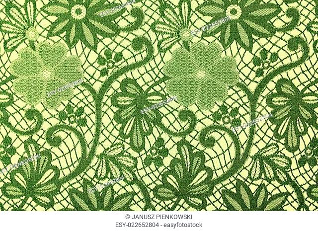 Green flowers on a textile background