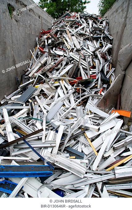 Skip full of aluminium extrusion from billets at a metal recycling