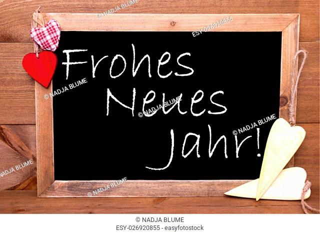 Chalkboard With German Text Frohes Neues Jahr Means Happy New Year. Red Textile And Wooden Yellow Hearts. Wooden Background With Vintage, Rustic Or Retro Style