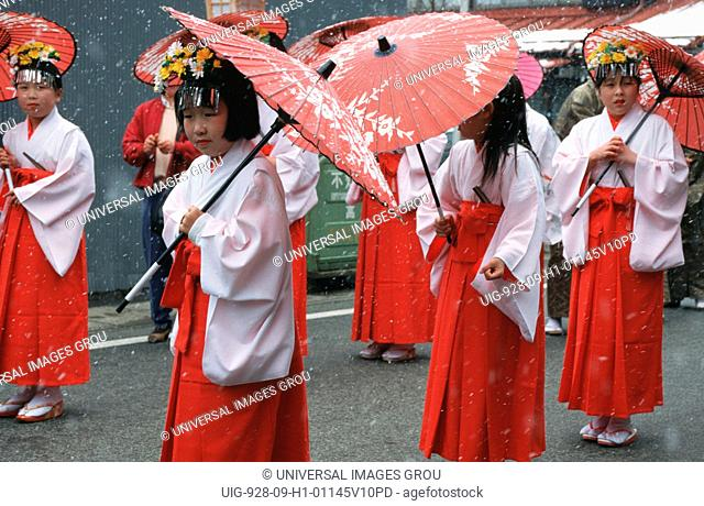 Japan, Takayama. Girls In Traditional Dress At Festival, With Umbrellas