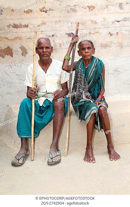 Old Couple sitting, SAWAR TRIBE, Khairmal Village, Saraipali Tahsil, Mahasamund District, Chattisgarh, India