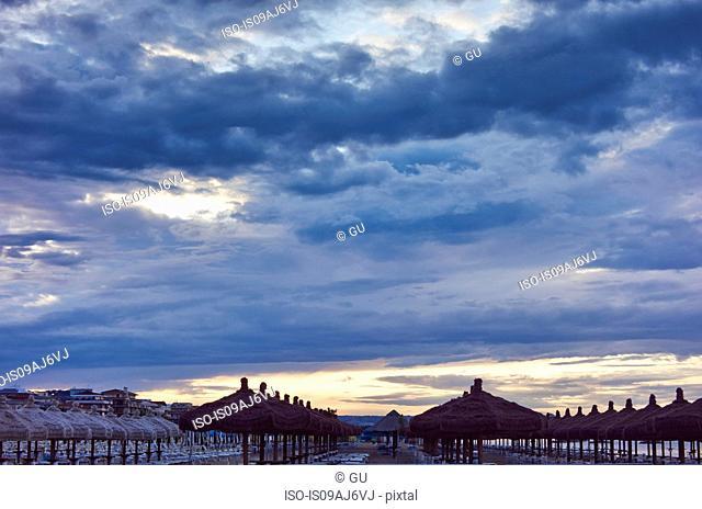 Rows of beach umbrellas at dusk, Pescara, Abruzzo, Italy