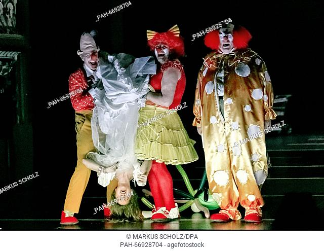 Actors Paul Herwig (L-R), Gala Othero Winter, Aljoscha Stadelmann and Josef Ostendorf perform on stage during the photo rehearsal of 'Peer Gynt' in Hamburg