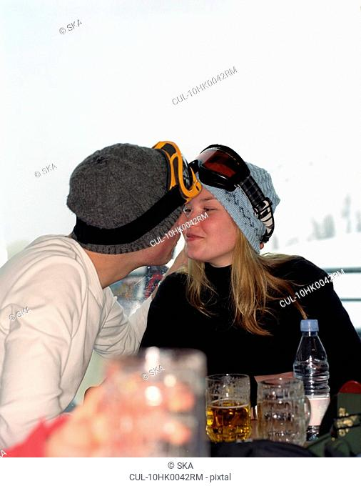 Couple touching heads wearing goggles