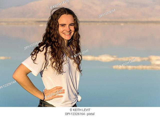 Portrait of a young woman standing with the Dead Sea in the background; South District, Israel