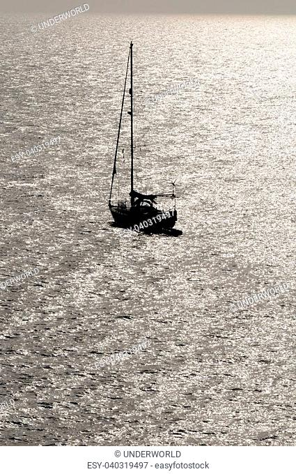 Silhouetted Sailing Boat on the Atlantic Ocean Near Canary Island