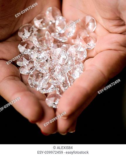 Pile of diamonds in woman hands