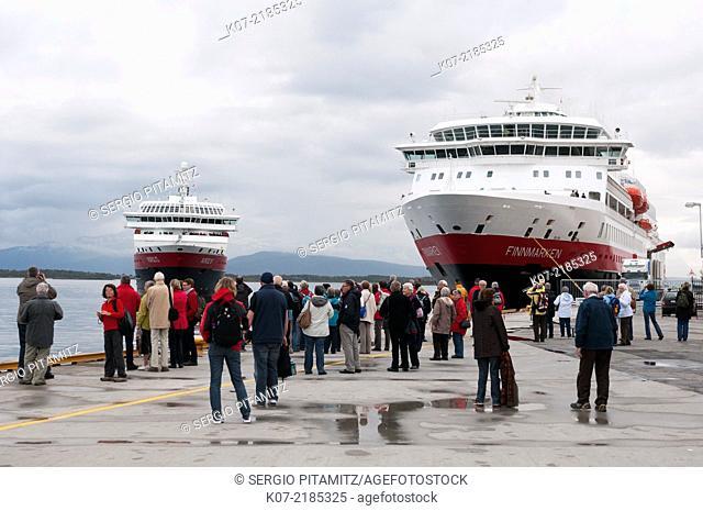 Tourist waiting Hurtigruten cruise ships in Molde, Norway