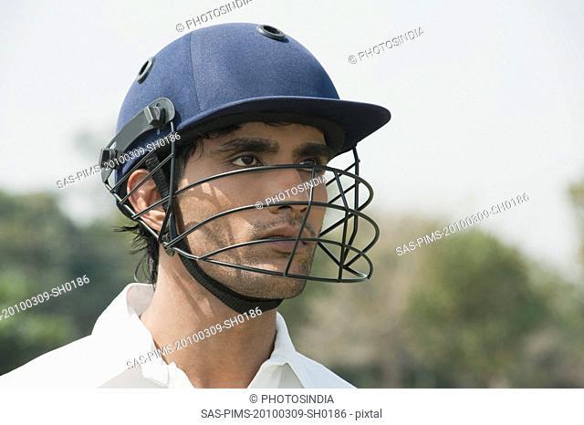 Cricket batsman wearing a helmet