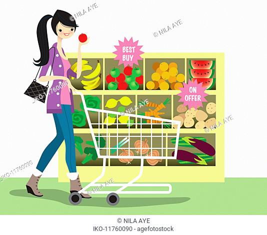 Young woman shopping for bargain fruit and vegetables in supermarket