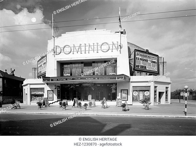 Dominion Cinema, Hounslow, London, 1932. Entrance front to the cinema. It is of an early Art Deco 'Moderne' style, with stepped detailing and sunray motifs on...