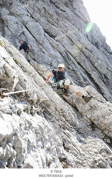Austria, Tyrol, Wilder Kaiser, two men on via ferrata