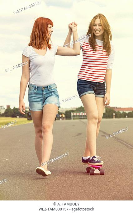 Two young women with skateboard