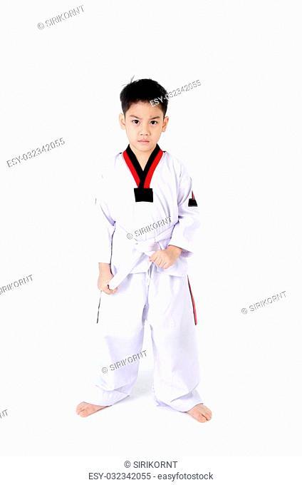 little cute boy in a Taekwondo uniform with a white sash on a white background