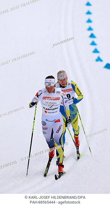 Charlotte Kalla from Sweden and Tetyana Antypenko (R) from Ukraine in action in the women's 10km cross country event at the Nordic Ski World Championship in...
