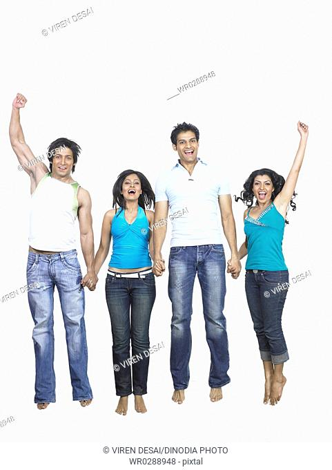 South Asian Indian men and women jumping with joy MR