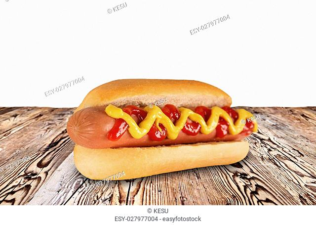 hot dog on wooden background, close-up