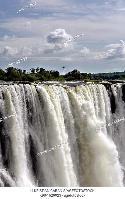 Victoria Falls with blue sky and clouds, Zimbabwe
