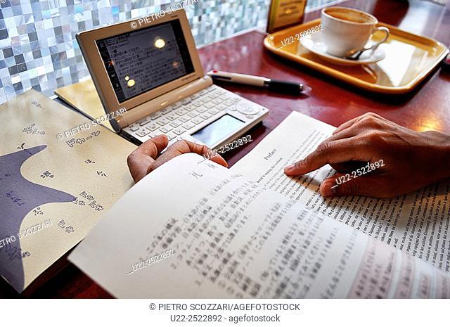Naha, Okinawa, Japan: studying English in a café