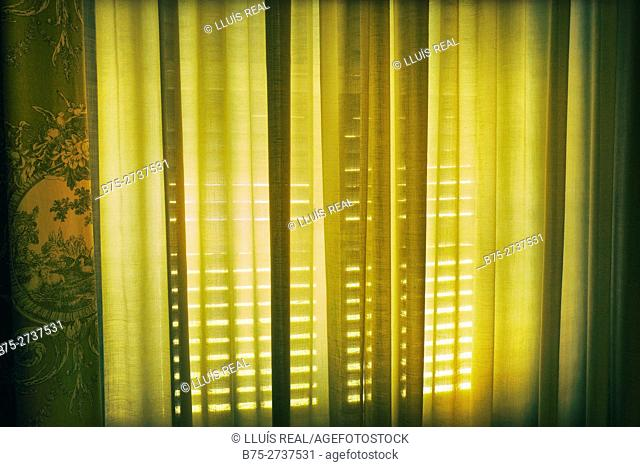 Close up of a closed window with curtain. Mahon, Minorca, Balearic Islands, Spain