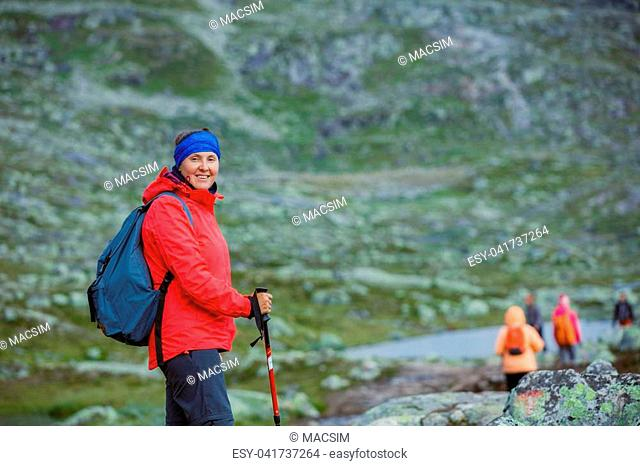 Best Norway hike. Woman with hiking equipment in the mountains
