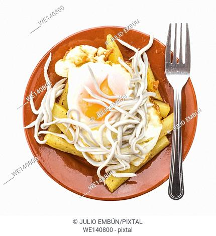 zenithal making fried egg on fried potatoes with baby eels, isolated on white