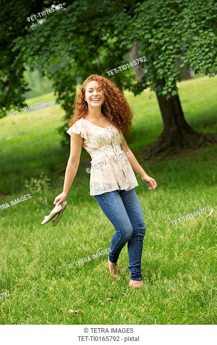 Young woman walking in park