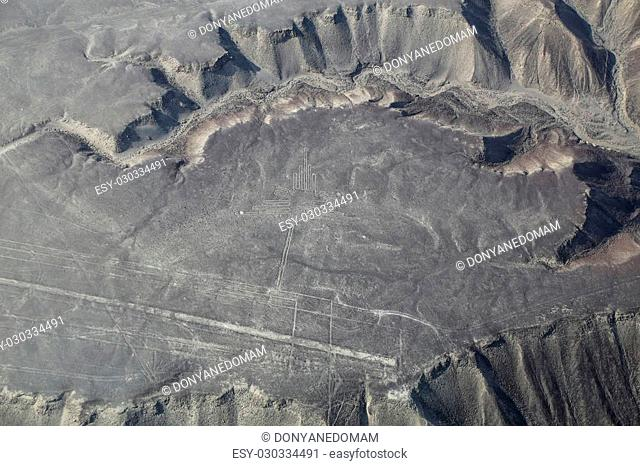 Aerial view of Nazca Lines - Hummingbird geoglyph, Peru. The Lines were designated as a UNESCO World Heritage Site in 1994