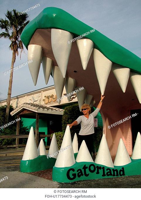 Orlando, FL, Florida, Gatorland, entrance, woman standing in the giant alligator jaws